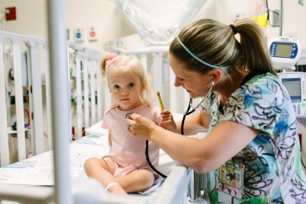 Little girl with Mott CHC nurse